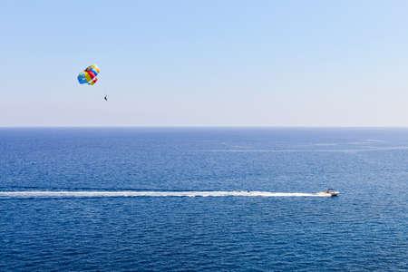 speedboat: Speedboat with parasailing on blue mediterranean sea Stock Photo
