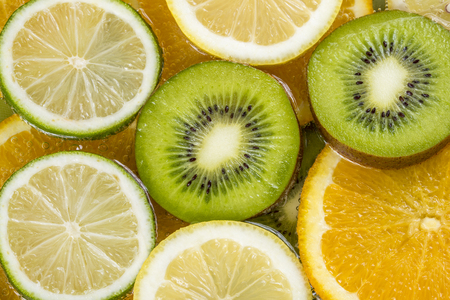 involving: Mix of different citrus fruits involving kiwi, orange, lemon and lime