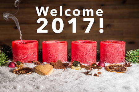 Four red blown out advent candles with fume and welcome 2017 writing as template Stock Photo