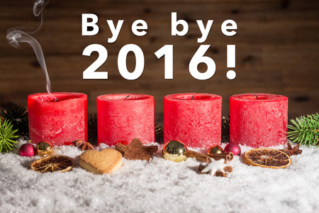 fume: Four red blown out advent candles with fume and bye bye 2016 writing as template Stock Photo