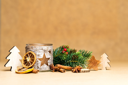 Christmas decoration and carved tea-light holder with stars in front of brown background as template