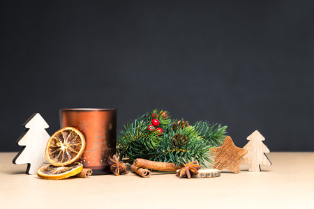 Christmas decoration and brown tea-light holder in front of brown background as greeting card Stock Photo