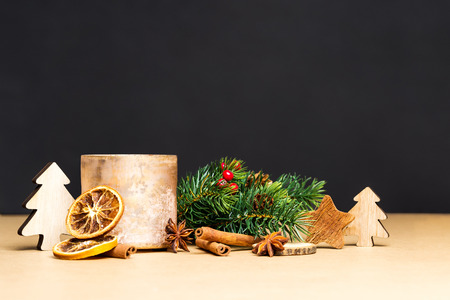 Christmas decoration and golden tea-light holder in front of black background as template