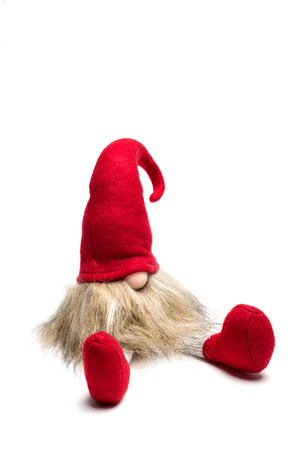 Red sitting christmas munchkin with pointed cap isolated as template