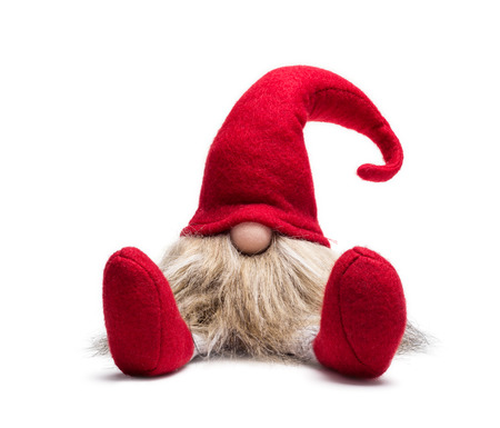 Red sitting christmas elf with pointed cap isolated as template