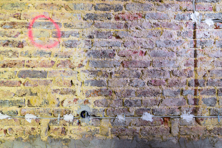 modernise: Old brick wall in a building prepared for restoration and renovation