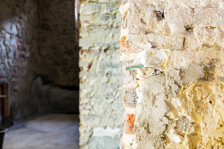 modernise: Old brick wall in a building prepared for construction and renovation