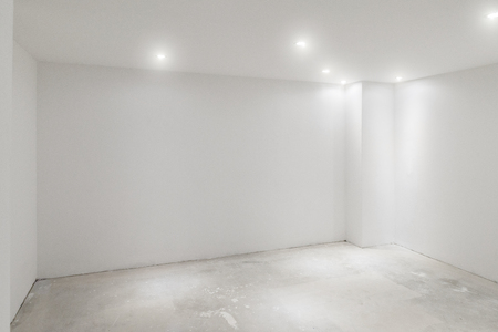 Empty Room With Whitewashed Floating Laminate Flooring And Newly