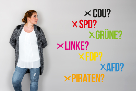 parliamentary: Young woman next to various german parties for german federal election 2017 Stock Photo