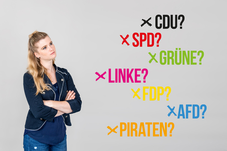 Young woman next to various german parties for german federal election 2017 Stock Photo