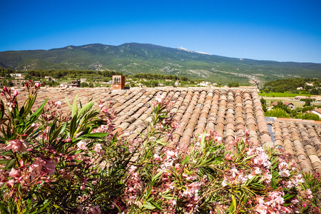Mediterranean roof with red tiles and blue sky and beautiful landscape in the background in France