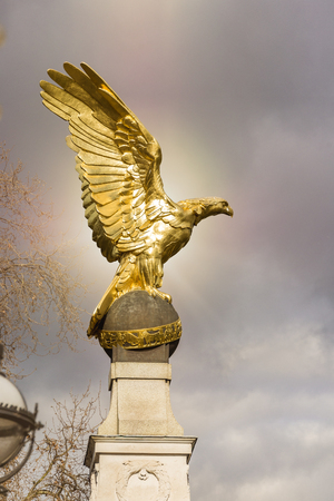Golden eagle statue as war memorial in London looking at Embankment of river Thames