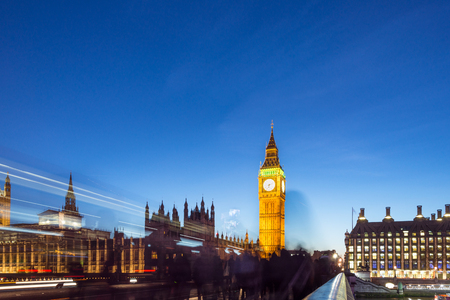 Houses of Parliament and Big Ben with double-decker buses at sunset in London, United Kingdom Stock Photo