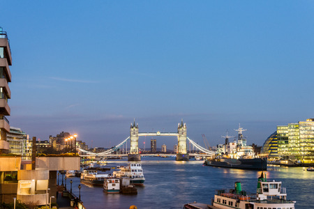 Lighted Tower Bridge in City of London during sunset Editorial