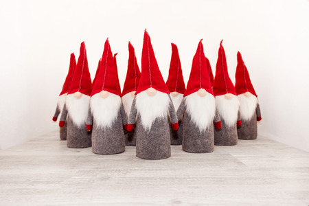 Group of christmas elf with pointed red cap isolated as template