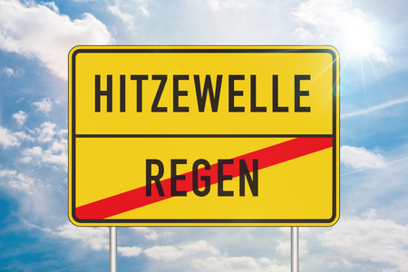 Yellow roadsign or place-name sign with heat wave and rain written in german and rain being crossed out against sunny sky with white clouds in background