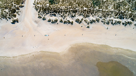 Dunes with green grass at beach in the Netherlands at the Northern Sea taken from above