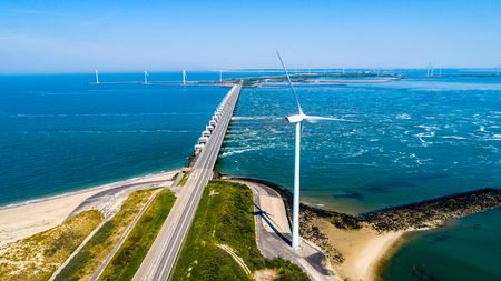 Oosterschelde flood barrier with windmills in the Netherlands at the Northern Sea taken from above 写真素材