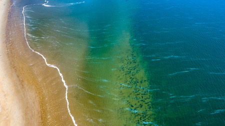Aerial view taken at a beach and blue sea as seaside from zeeland in the Netherlands 写真素材