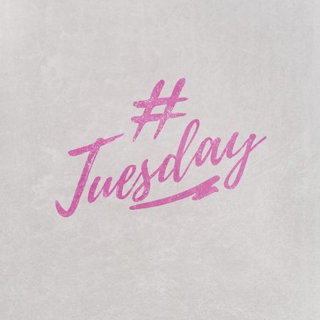 # Hashtag Tuesday written in orange on grey background as template in handwritten style