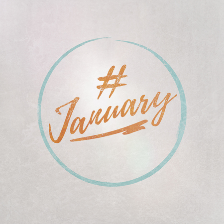# Hashtag January written in orange on grey background as template in handwritten style 写真素材