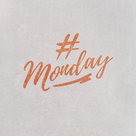 # Hashtag Monday written in orange on grey background as template in handwritten style