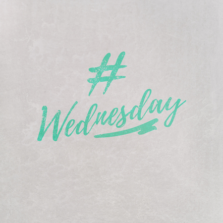 # Hashtag Wednesday written in orange on grey background as template in handwritten style 写真素材