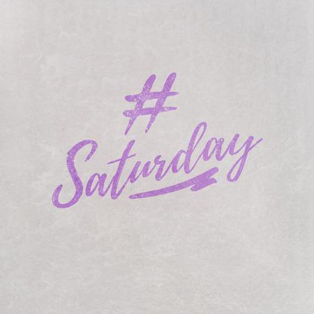 # Hashtag Saturday escrito en naranja sobre fondo gris como plantilla en estilo manuscrito