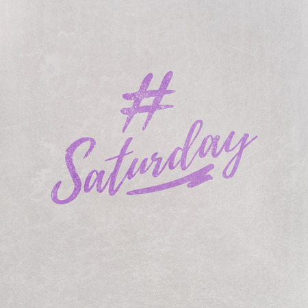 # Hashtag Saturday written in orange on grey background as template in handwritten style