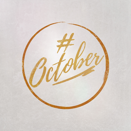 # Hashtag October written in orange on grey background as template in handwritten style 写真素材