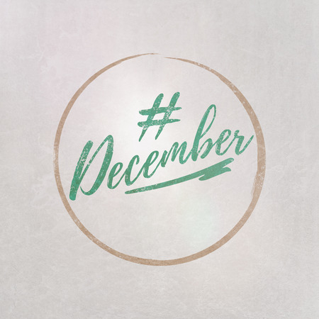 # Hashtag December written in green on grey background as template in handwritten style