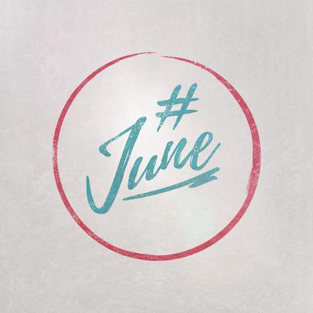 # Hashtag June written in blue on grey background as template in handwritten style