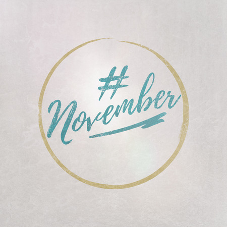 # Hashtag November written in blue on grey background as template in handwritten style