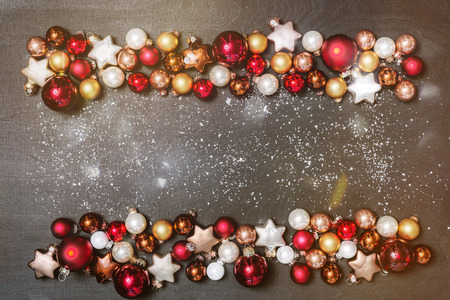 Christmas bulbs decoration as frame with copy space for happy new year message against black background as flatlay from above 写真素材