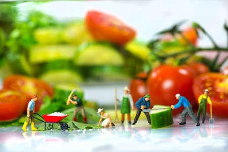 Little workers preparing salad photo