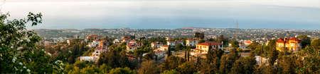 pano: Panoramic view from Bellapais Abbey towards Kyrenia on sunset.