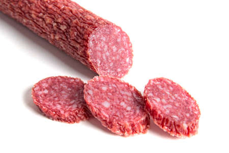 gastronome: Sliced sausage isolated on white background