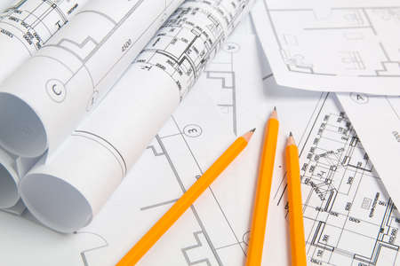 Paper architectural drawings, blueprint and pencil. Engineering blueprint.