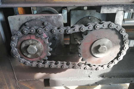 Chain drive. Driving roller chain on the drive sprocket in operation