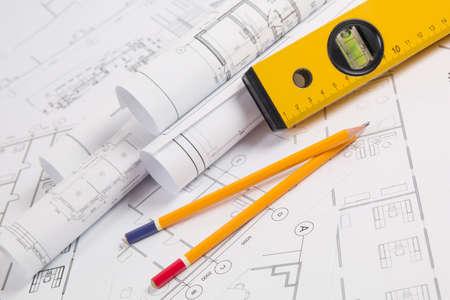 Pencils, spirit level drawings and blueprints. Stok Fotoğraf