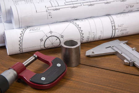 Engineer work. Drawings, measuring tools and details of chains on the table. Stok Fotoğraf