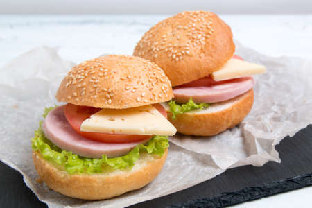 baguette sandwich with ham, cheese, tomatoes and lettuce