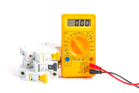 modular circuit breaker and digital multimeter on white background Stockfoto