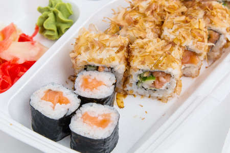 Japanese food. Sushi rolls set in food delivery box.