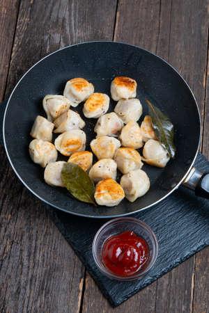 fried russian dumplings in a pan