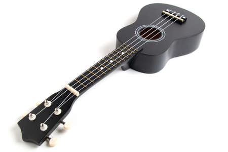 black ukulele guitar on white background