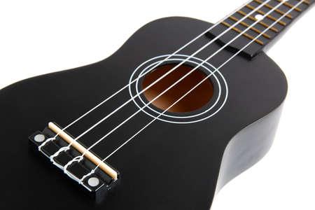 black ukulele guitar on white background