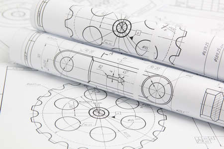 Rollos de papel dibujos de ingeniería de mecanismos y máquinas.