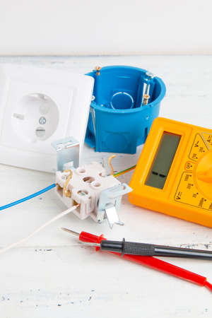 digital multimeter, electrical outlet and circuit breaker Banque d'images