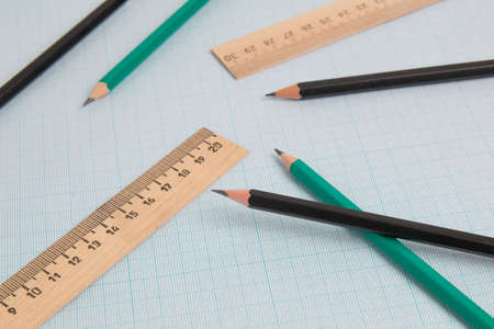 pencils end engineering ruler on graph paper